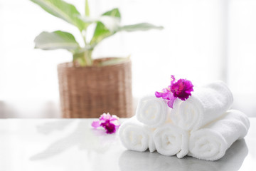 Towels on table with copy space blurred bathroom background. For product display montage.