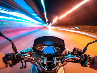 Biker driving a motorcycle in the city street night scene first person angle view Wall mural
