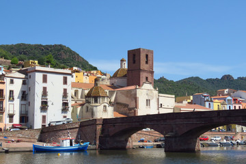 Picturesque view of church and bridge over the river in the historic town of Bosa, Sardinia, Italy