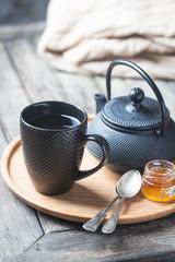 tea cup with tea pot on a tray