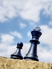 King pawn chess pieces on a wall