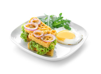 Plate with delicious waffles and fried egg on white background