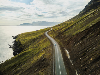 car driving on beautiful road, travel background, aerial scenic landscape from Iceland