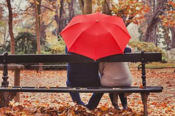 love, happy elderly couple in love, retired people enjoying romantic moment in autumn park, fall season