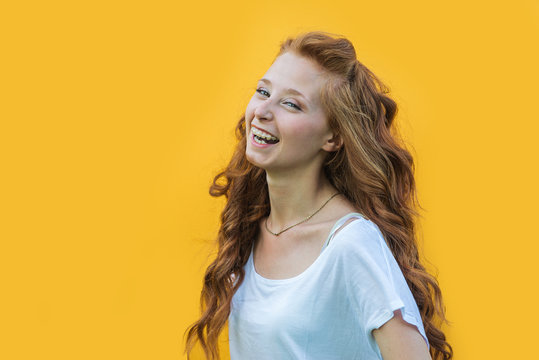 Young teen portrait on colored background