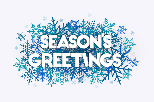 Season's Greetings concept with snowflakes in the background. Decorative design with snow burst.