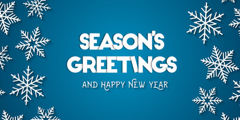 Season's Greetings and Happy New Year greeting card concept with white snowflakes and blue background