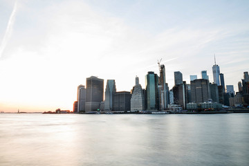 Wall Mural - View of the city of New York and the bay. New York.  Minimalism. Long light exposure.
