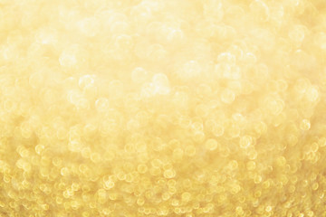 Abstract Gold glitter festive Christmas texture background blur with bokeh light