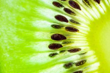 Fresh kiwi fruit slices closeup macro texture background
