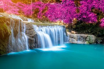 Amazing in nature, wonderful waterfall at autumn forest in fall season.