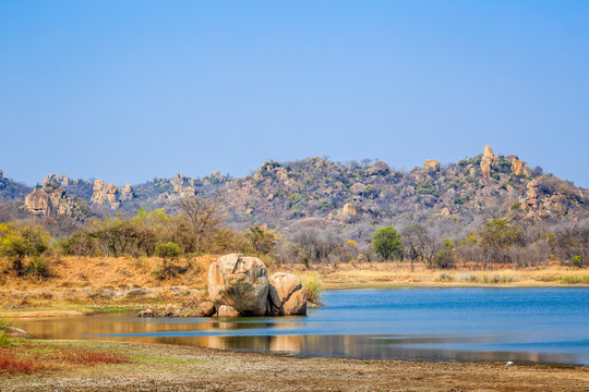 View of a lake surrounded by rocks, in Matobo National Park, Zimbabwe. September 26, 2016.
