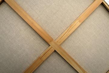 tableau à l'envers. Croix de bois devant la toile blanche Fotoväggar