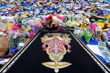 Tributes for Leicester City's owner Vichai Srivaddhanaprabha, and four other people who died when their helicopter crashed on Saturday, are seen at the King Power Stadium in Leicester
