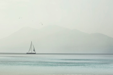 sailboat glides lightly on the waves of a pristine ocean