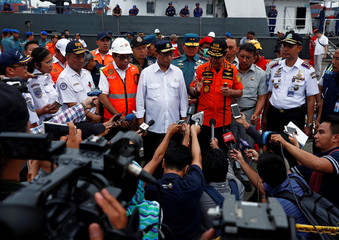Indonesia's Transport Minister Budi Karya Sumadi and chief of search and rescue operations Muhammad Syaugi speak to the media on the rescue operation of Lion Air flight JT610 at Tanjung Priok port in Jakarta