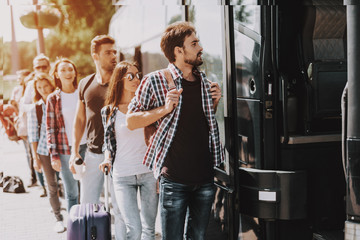 Group of Young People Boarding on Travel Bus Wall mural