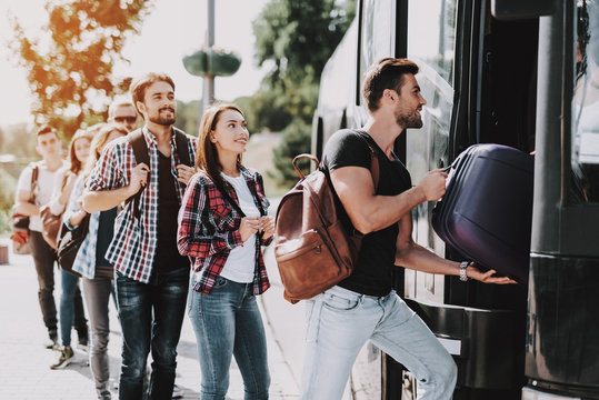 Group of Young People Boarding on Travel Bus