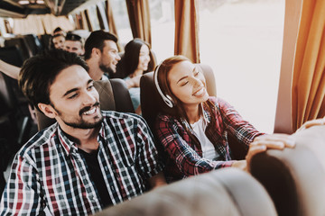 Young Smiling Couple Traveling on Tourist Bus