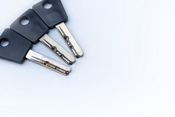 Three modern off door key lock on white background.