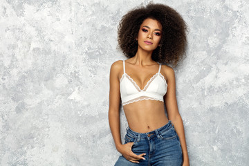 Wall Mural - Beautiful black woman with an afro hairstyle and copy space wear white bra