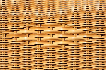 Closeup of decorated wicker basket or rattan chair textured background with design pattern in centre