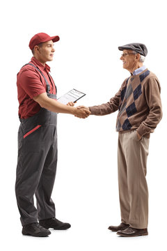 Mover shaking hands with a senior man