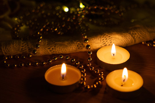 three lighted new year candles