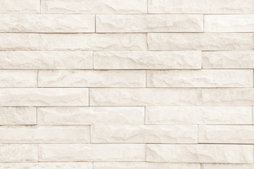 Seamless cream pattern of decorative brick sandstone wall surface with concrete of modern style...