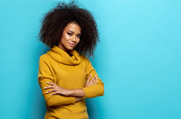 Wall Mural - Beautiful african american woman with afro looking at camera