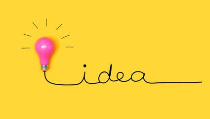Wall Mural - Idea hand writing text with a light bulb
