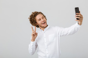 Portrait of a cheerful young man with curly hair