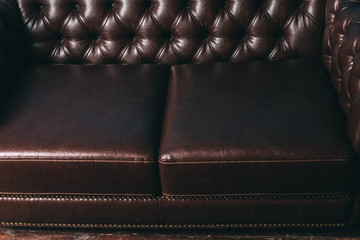 luxurious leather, brown sofa. classic vintage furniture.