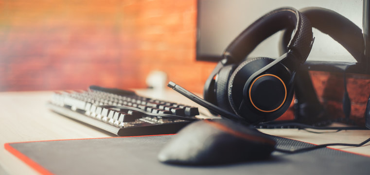 Gaming arena background with mouse gear headphones computer, focuse on headphones selected focuse long banner