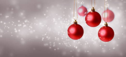 Collection of Christmas baubles on a shiny light background