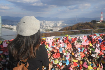 Tourist is traveling on the N Seould tower in South Korea.