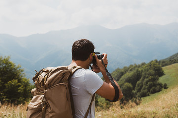 Anonymous traveler taking pictures of nature