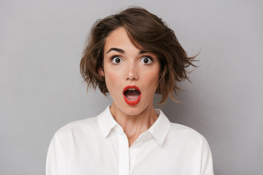 Portrait of a shocked young woman
