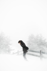 Young woman walking in countryside in winter