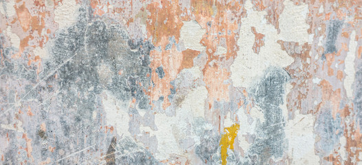 Old cracked weathered shabby plastered peeled wall banner background