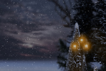 glowing vintage street light with snow
