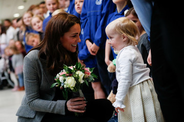 Britain's Catherine, Duchess of Cambridge, is given a bunch of flowers during a visit to Coach Core Essex, in Basildon