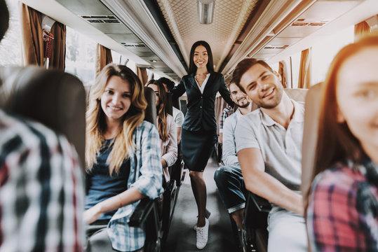 Female Tour Service Employee at Work on Tour Bus