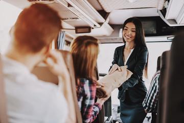 Female Tour Service Employee at Work on Tour Bus Fototapete