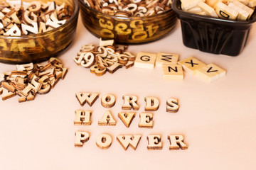 wooden letters forming words have power text