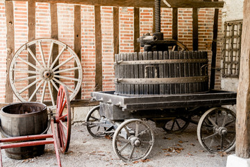 Old vintage barrels at the rural farm at Chateau de Chenonceau, Chenonceau castle in Loire Valley area in France.