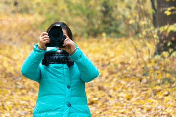 professional camera in children's hands, a small photographer