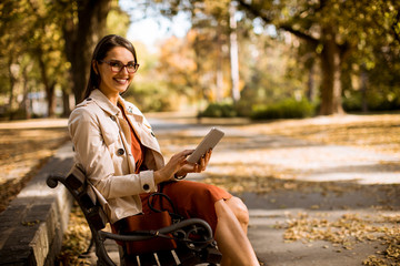 Young woman using digital tablet in the park