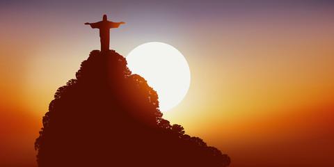 Coucher de soleil sur le Corcovado, célèbre monument brésilien au dessus de la baie de Rio de Janeiro.