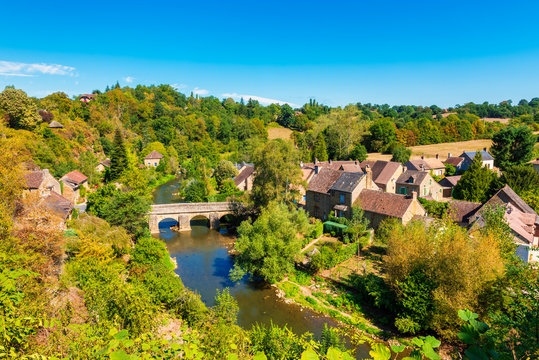 Village of Saint-Céneri-le-Gérei along the Sarthe river in Normandy, France. The village is considered to be one of the most beautiful in France.